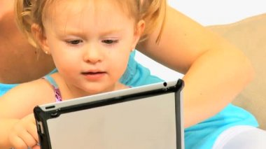 Cute Pre School Girl Playing Tablet Home Sofa Close Up — Stock Video