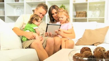 Family playing games on tablet at home — Stock Video