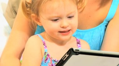 Pre School Girl Parent Using Wireless Tablet Close Up — Stock Video