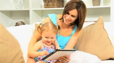 Pre School Girl Parent Using Wireless Tablet — Wideo stockowe