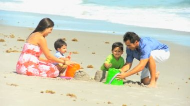 Young Hispanic Family Playing Sand Beach Outing — Wideo stockowe