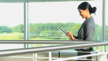 Businesswoman with tablet in airport — Stock Video