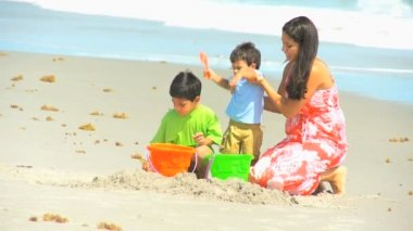 Cute Hispanic Brothers Making Sandcastles Mother — Stock Video