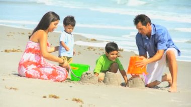 Cute Hispanic Brothers Making Sandcastles with Parents — Stock Video
