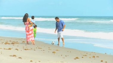 Happy Ethnic Parents Cute Sons Playing Ball Beach — Stock Video