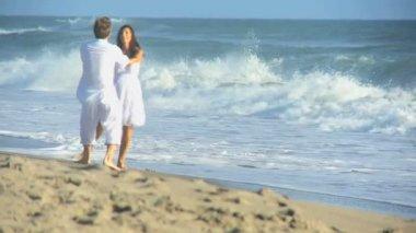 Carefree Caucasian Couple Enjoying Beach Vacation — Stock Video