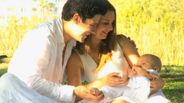 Young couple playing with baby — Stock Video