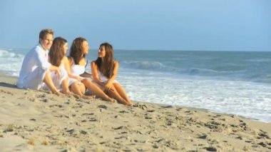 Caucasian Family Wearing White Outdoors Together Beach — Stock Video