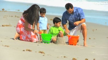 Happy Ethnic Parents Cute Sons Playing Beach Buckets — Stock Video