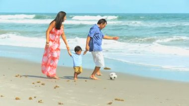 Young Hispanic Family Playing Football Beach Outing — Wideo stockowe