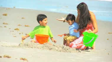 Happy Ethnic Mom Cute Sons Playing Beach Buckets — Stock Video
