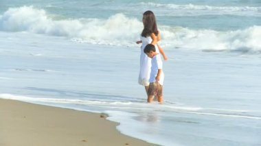 Hispanic Loving Mother Little Boys Ocean Surf — Stock Video