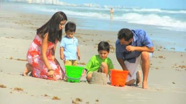 Young Hispanic Family Playing Sand Beach Outing — Stock Video