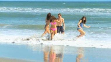 Caucasian Family Wearing Swimwear in Ocean — Stock Video