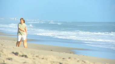 Teenage Girls Joining Parents on Beach — Stock Video