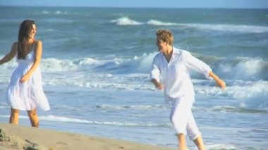 Attractive Couple Enjoying Time Walking Beach — Stock Video