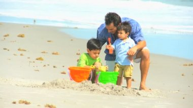 Young Hispanic Boys Father Playing Sand Beach Outing — Vídeo Stock