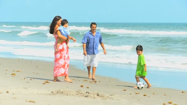 Young Hispanic Family Playing Football Beach Outing — Vidéo