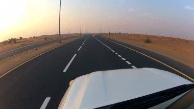 Vehicle on desert tarmac roads — Stock Video