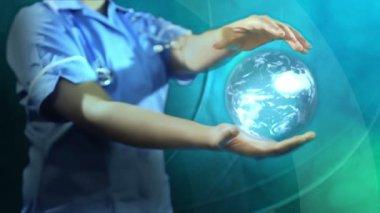 Nurse holding digital rotating world globe — Stock Video