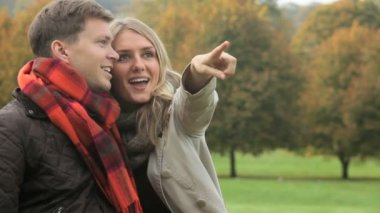 Laughing Caucasian Couple Outdoors Autumn Park — Stock Video