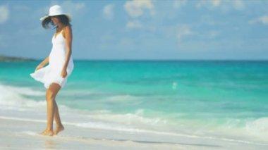 Laughing Ethnic Girl Splashing Ocean Waves — Stock Video