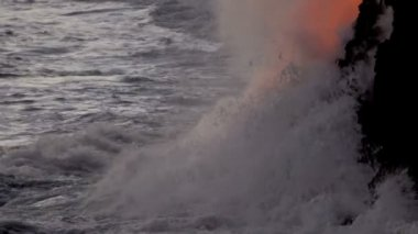 Molten lava pouring into ocean waters — Стоковое видео