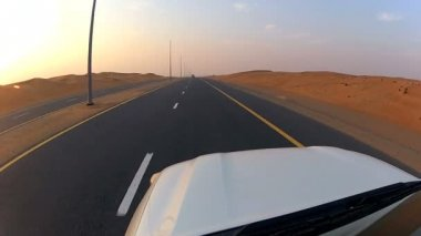 Vehicle on desert tarmac roads — Stockvideo
