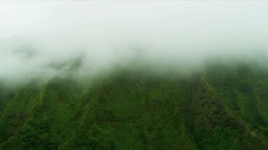 Misty cloud covered volcanic cliffs — Stock Video