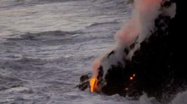Molten lava pouring into ocean waters — Stockvideo