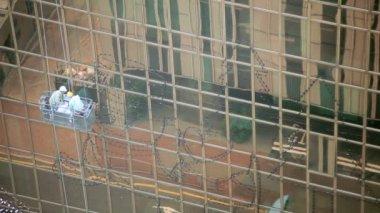 Window maintenance on glass skyscrapers in Hong Kong — Stock Video