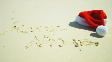 Seasonal Greeting Sand Beside Santa Hat — Stock Video