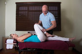 Chiropractor Stretching Female the patient leg — Stock Photo