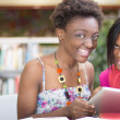 African Students doing research at the library — Stock Photo #36790603