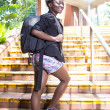 African American Student on the college stairs — Stock Photo #36793145