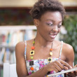 Young black student doing Library research — Stock Photo