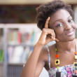 AfricAmericstudent Studying in Library — Stock Photo #36793513