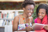African Students doing research at the library — Stockfoto
