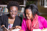 African American Students helping with assignment — Stock Photo
