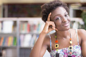 African American student Studying in the Library — Stock Photo