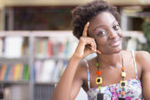 Young african american student studing library — Stock Photo
