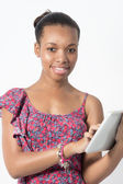Young African American woman typing on her tablet — Stockfoto