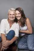 Young Daughter and older Mother laugh together — Stock Photo