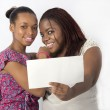 Best Friends holding a blank board infront — Stock Photo #43378085