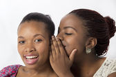 Best Black Female Friends gossip behind hands — Stock Photo