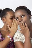 Black Best Friends talking gossip behand hands — Stock Photo