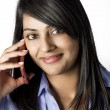 Beautiful Indian Woman talking on the phone — Stock Photo #44619203