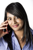 Beautiful Indian Woman talking on the phone — Stock Photo