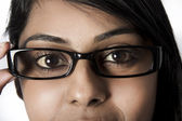 Closeup of Woman brown eyes with framed glasses — Foto de Stock