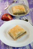 Baklava with apples on a white plate — Стоковое фото